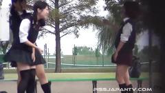 Kinky Asian schoolgirls shamelessly piss outdoor