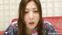 Bosomy Asian doll close up toy insertion