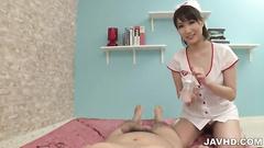 Kinky nurse stroking and feet jobbing cock