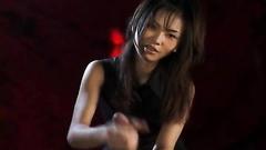 Asian girl smiling when stroking the piston
