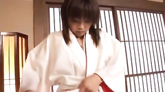 Babe in traditional clothes enjoys his skilled fingers