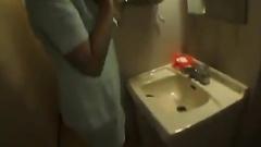 Slender Asian horny chick hotly masturbates on toilet