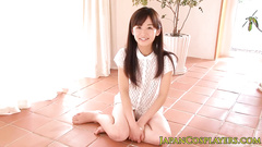 Adorable young Japanese girl hotly poses in sexy blouse