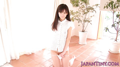 Wonderful Asian girl hotly poses in white peignoir