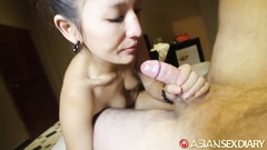 Skinny Asian girl sucks big white dick and enjoys hardcore fuck