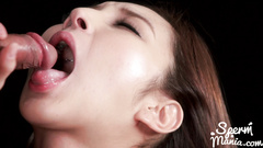 Brown haired Japanese girl sucks out cumload and handjobbing dick